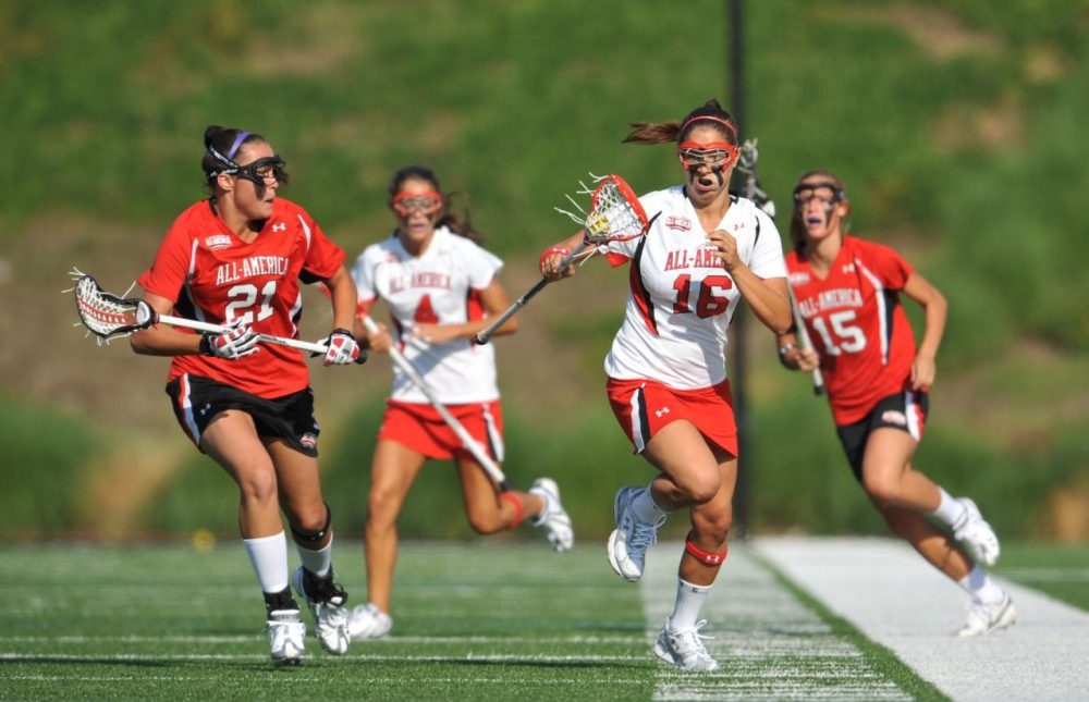 In women's lacrosse, athletes are not required to wear helmets. Florida has become the first state requiring female lax players wear protective head gear.  (Larry French/Getty Images for Under Armour)