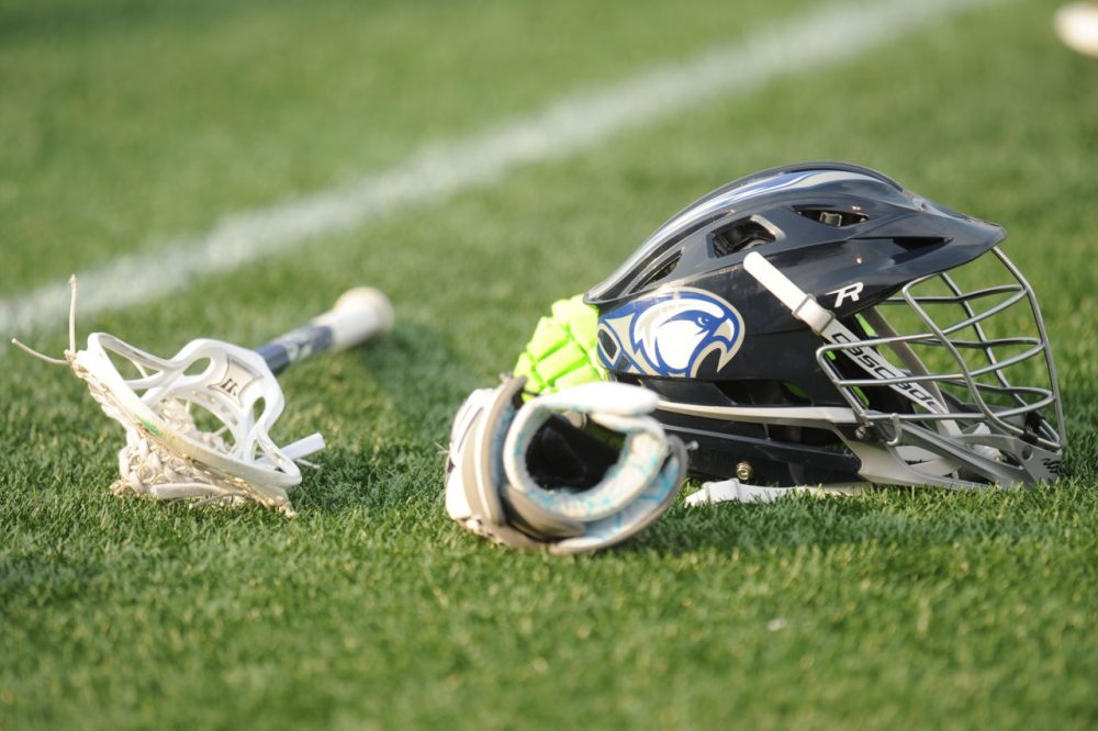 Male lacrosse players are required to wear helmets. Florida became the first state to require female lacrosse athletes to do the same. (Mitchell Layton/Getty Images)
