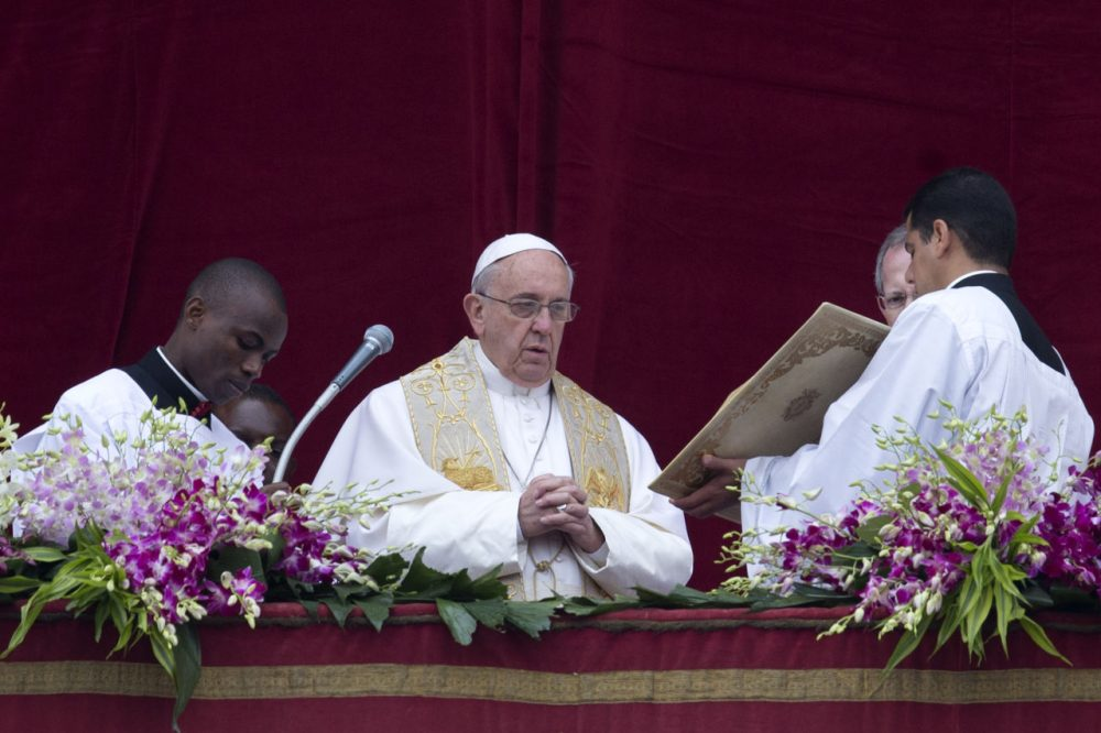 Pope Francis speaks before delivering the Urbi et Orbi (to the city and to the world) blessing at the end of the Easter Sunday Mass in St. Peter's Square at the Vatican , Sunday, April 5, 2015. (AP Photo/Andrew Medichini)