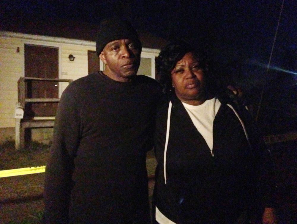 Lloyd Edwards, left, and Bonnie Edwards, the stepfather and mother of Rodney Todd stand outside the home where Todd and his seven children found dead Monday, April 6, 2015, in Princess Anne, Md. Police found the bodies at the home after being contacted by a concerned co-worker of the father, who had not been seen for days, Princess Anne police said in a news release. (Juliet Linderman/AP)