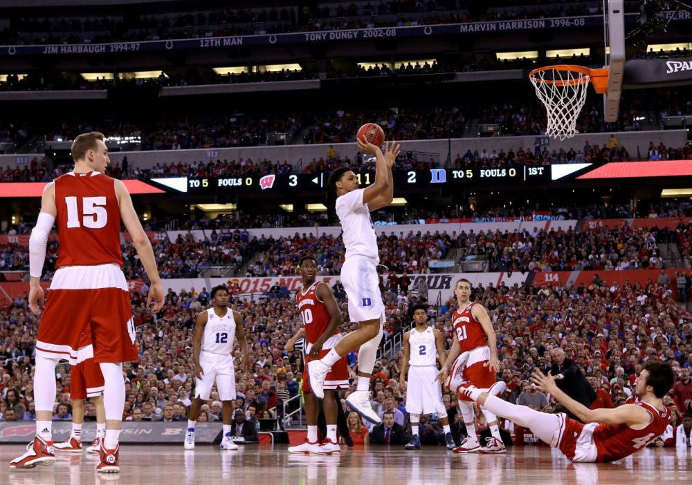 Jahlil Okafor #15 of the Duke Blue Devils shoots against Frank Kaminsky #44 of the Wisconsin Badgers in the first half during the NCAA Men's Final Four National Championship at Lucas Oil Stadium on April 6, 2015 in Indianapolis, Indiana. (Streeter Lecka/Getty Images)