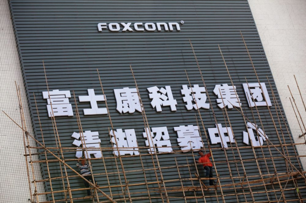Workers put up scaffolding on a building owned by the contract manufacturer Foxconn International Holdings Ltd on November 28, 2010 in Shenzhen, China. (Daniel Berehulak/Getty Images)