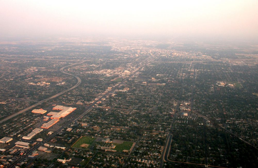 Fresno, California, is pictured from a plane window in 2008, hazy due to wildfires. (purpletwinkie/Flickr)