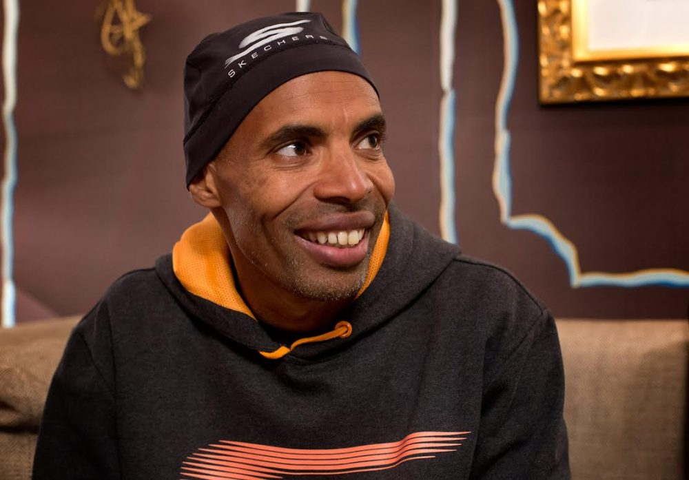 Meb Keflezighi's new book is a guide for runners training for the marathon. He is the 2014 Boston marathon winner and an Olympian. (Robin Lubbock/WBUR)