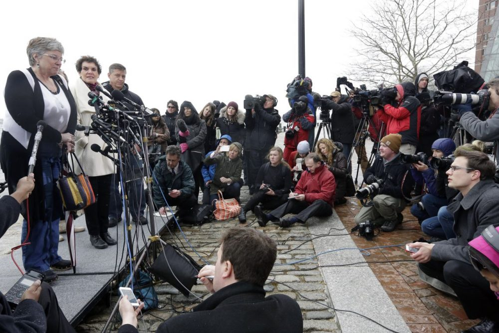 Boston Marathon bombing survivor Karen Brassard, left, speaks outside federal court alongside Laurie Scher, second from left, and Mike Ward, third from left, Wednesday, April 8, 2015, in Boston where Dzhokhar Tsarnaev was convicted on multiple charges in the 2013 Boston Marathon bombing. Three people were killed and more than 260 were injured when twin pressure-cooker bombs exploded near the finish line. (Steven Senne/AP)