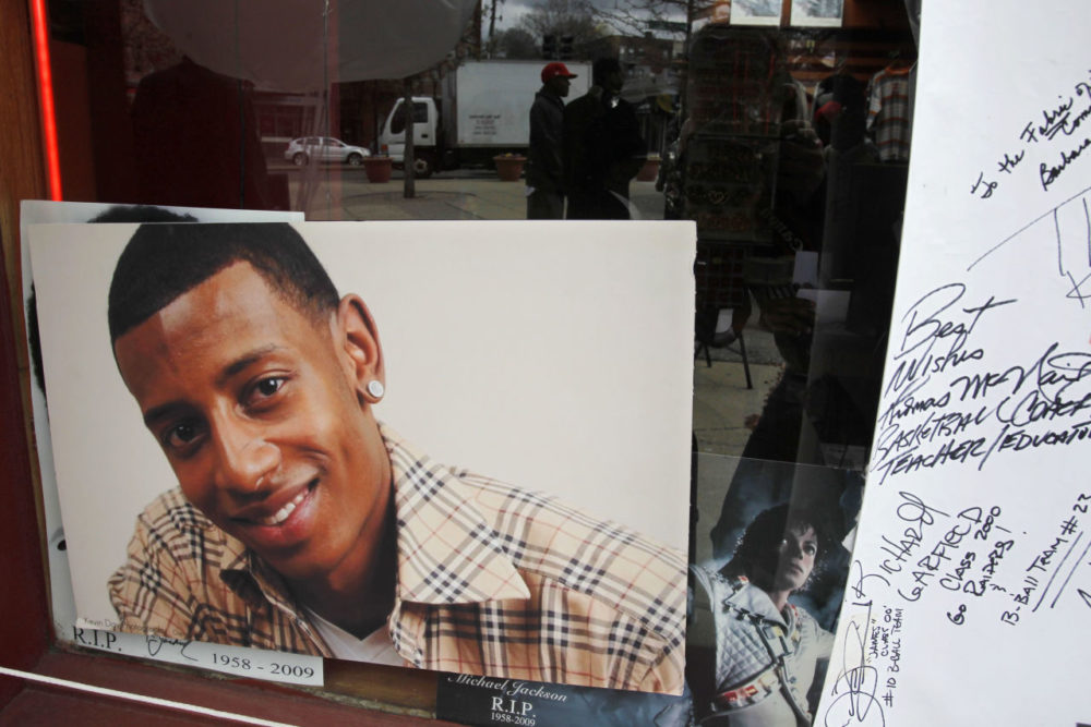 A photograph of college football player Danroy Henry Jr., who was shot and killed by a police officer, is seen in the window of a radio station, in Boston's Roxbury neighborhood in April 2011. (Steven Senne/AP)