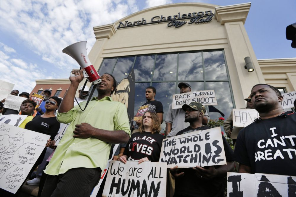 Muhiydin D'Baha leads a group protesting the shooting death of Walter Scott at city hall in North Charleston, S.C., Wednesday, April 8, 2015. Scott was killed by a North Charleston police office after a traffic stop on Saturday. The officer, Michael Thomas Slager, has been charged with murder. (Chuck Burto/AP)