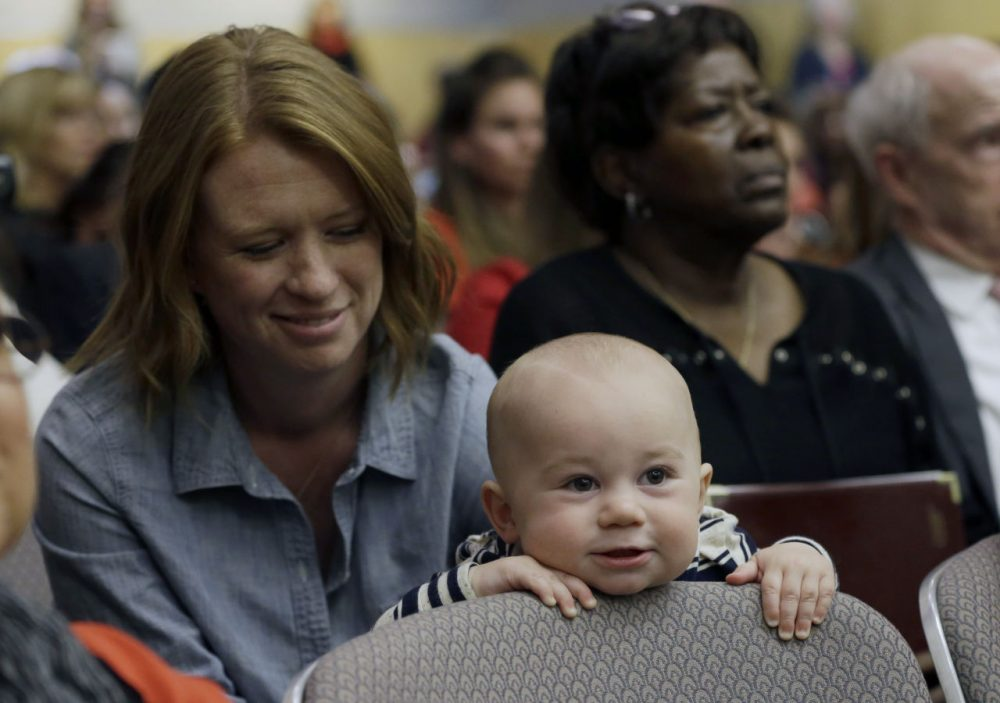 Jennifer Wonnacott, a supporter of a measure requiring California schoolchildren to get vaccinated, keeps an eye on her son, Gavin, at a hearing at the Capitol in Sacramento, Calif., Wednesday, April 8, 2015. Supporters and opponents of the SB277, by Sens. Richard Pan, D-Sacramento and Ben Allen, D-Santa Monica, spoke passionately during the hearing in the Senate Health Committee. (Rich Pedroncelli/AP)