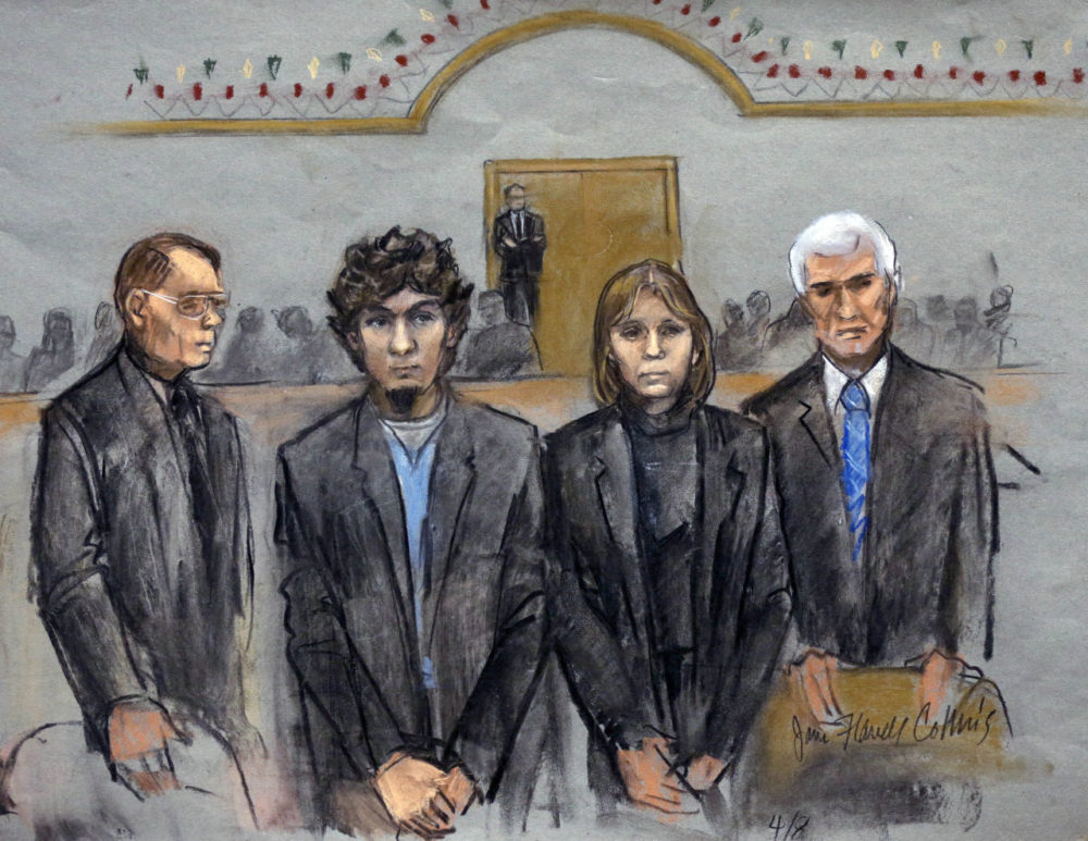 In this courtroom sketch, Dzhokhar Tsarnaev, second from left, is depicted standing with his defense attorneys William Fick, left, Judy Clarke, second from right, and David Bruck, right, as the jury presents its verdict in his federal death penalty trial. The jury found Tsarnaev guilty. (Jane Flavell Collins/AP)