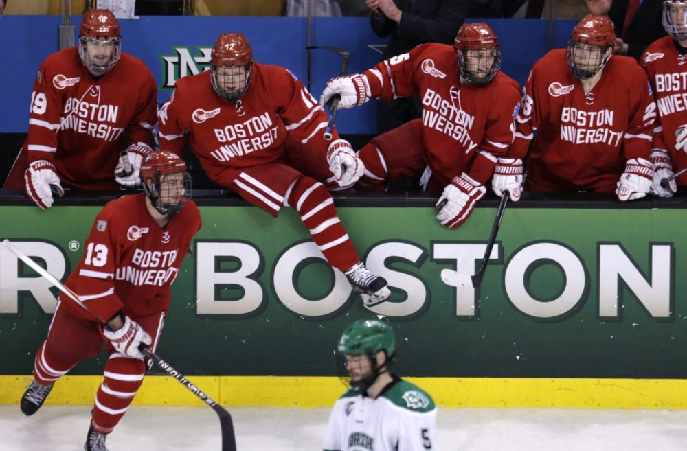 Boston University players leap over the boards after a win against North Dakota in a semifinal at the NCAA men's Frozen Four hockey tournament in Boston, Thursday, April 9, 2015. BU defeated North Dakota 5-3 and will play Providence in the championship game. (Charles Krupa/AP)
