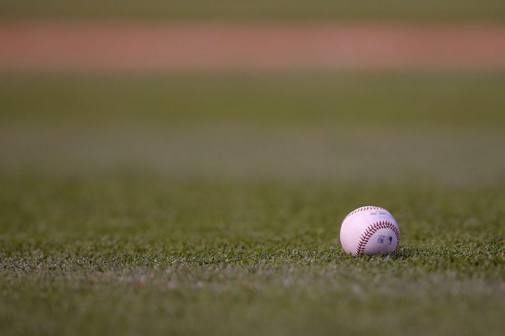 There's no reason to be alone. If you're still looking for an MLB team to root for, consider taking Brian Costa and Geoff Foster's Fan Compatibility Test. (Doug Pensinger/Getty Images)