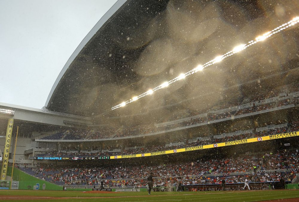 The Miami marlins' retractable roof took 16 minutes to close after an unexpected downpour of rain on Opening Day.  (Mike Ehrmann/Getty Images)
