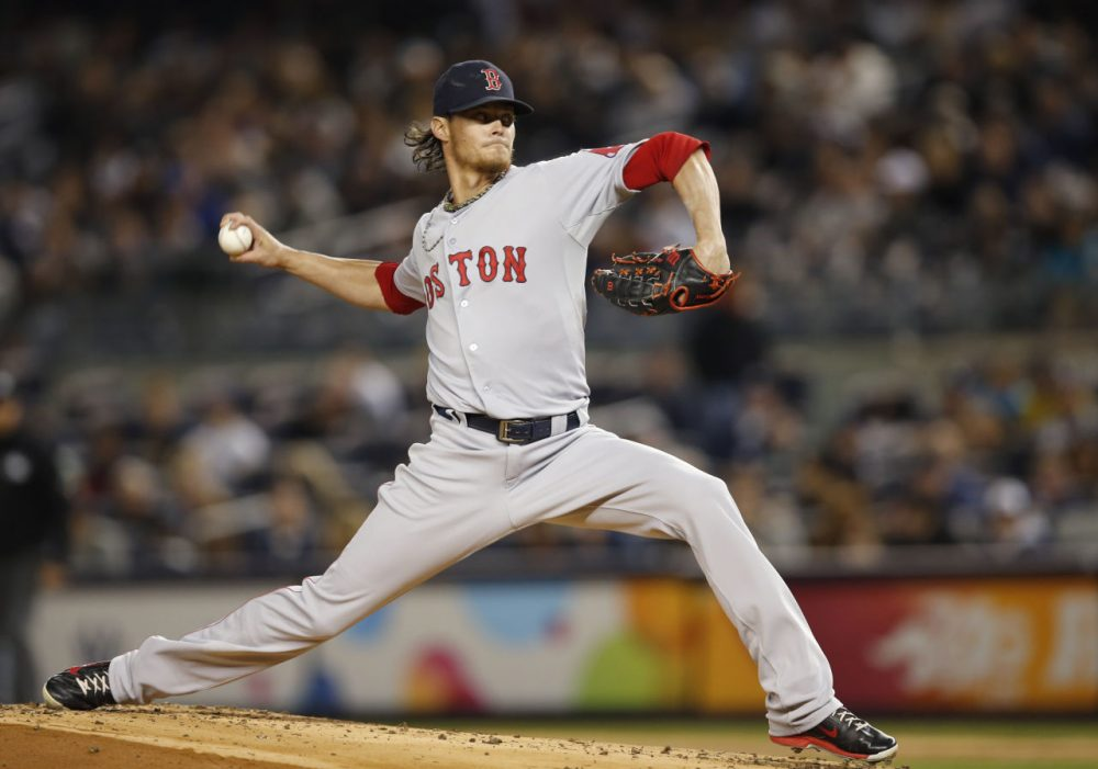 Starting pitcher Clay Buchholz winds up in the first inning against the New York Yankees in New York. (Kathy Willens/AP)