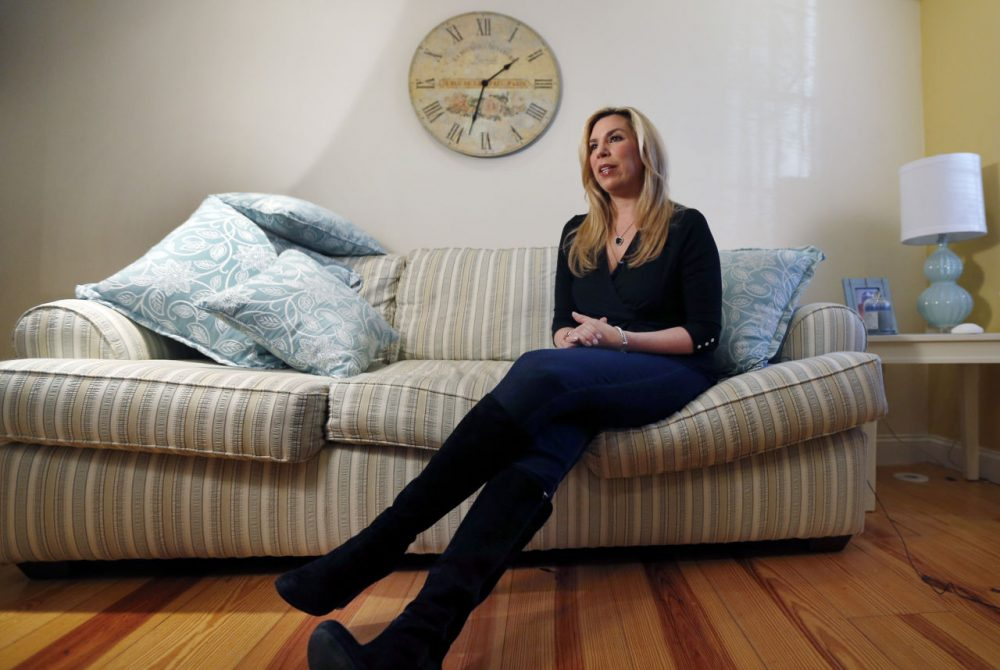 Boston Marathon bombing survivor Heather Abbott speaks during an interview at her home in Newport, R.I., in December 2014. For Abbott, who lost her left leg, One Fund Boston helped cover the costly prosthetics that allowed her to reclaim some degree of normalcy. (Elise Amendola/AP)