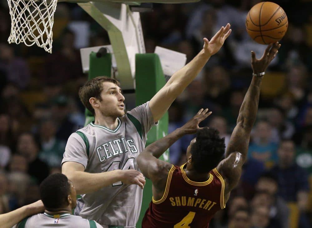 Boston Celtics center Tyler Zeller, left, reaches to block a shot by Cleveland Cavaliers guard Iman Shumpert. (Steven Senne/AP)