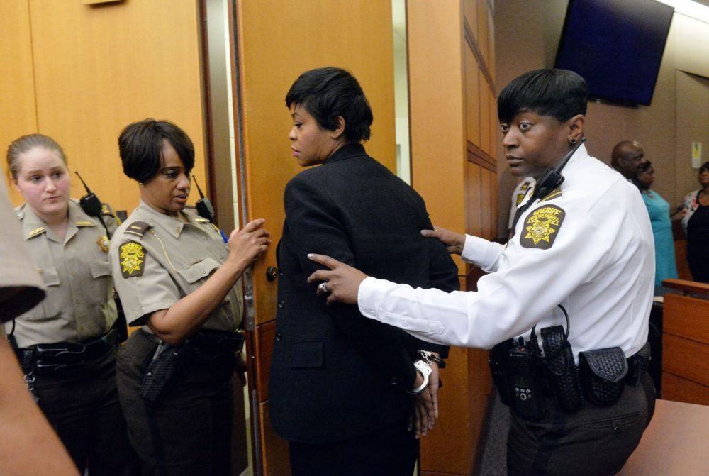 Former Deerwood Academy assistant principal Tabeeka Jordan, center, is led to a holding cell after a jury found her guilty in the Atlanta Public Schools test-cheating trial, Wednesday, April 1, 2015, in Atlanta. Jordan and 10 other former Atlanta Public Schools educators accused of participating in a test cheating conspiracy that drew nationwide attention were convicted Wednesday of racketeering charges. (Kent D. Johnson/Atlanta Journal-Constitution via AP)
