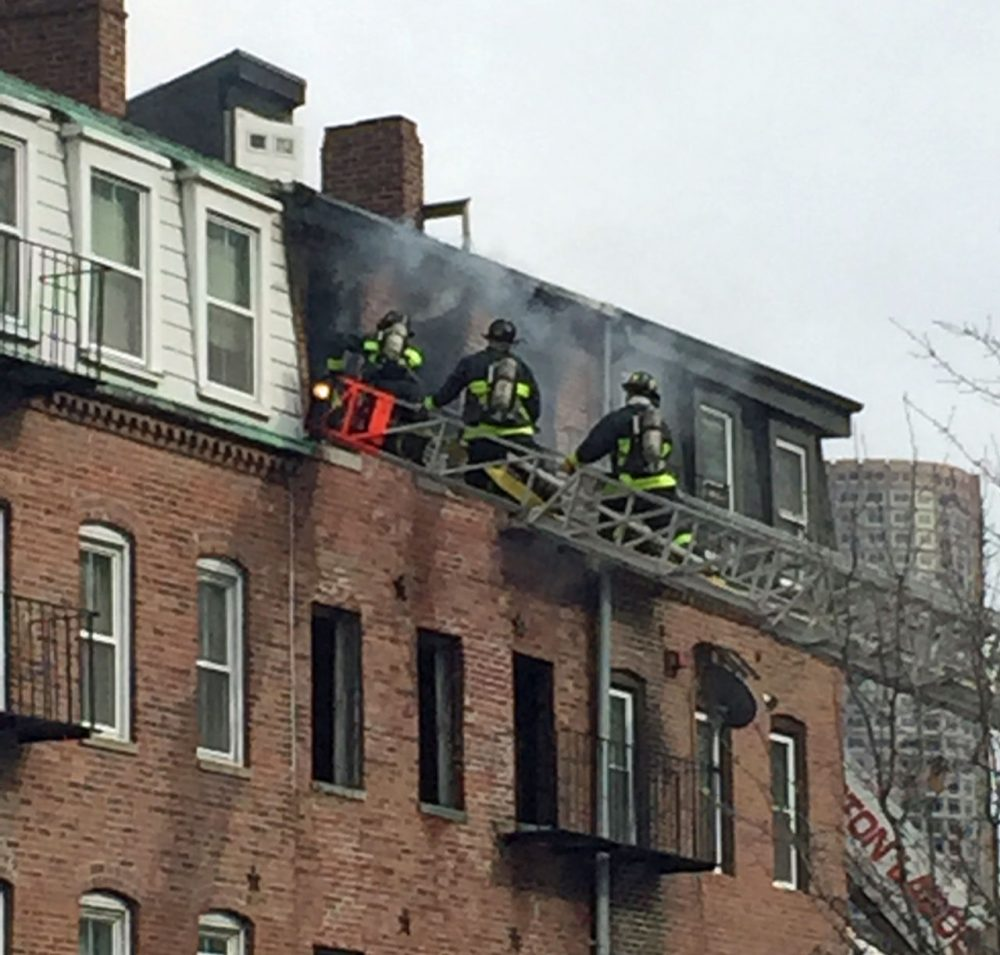 A two-alarm fire caused an estimated $1 million in damage to a vacant apartment building in Boston's North End Tuesday afternoon. (Courtesy Matt Sloan)