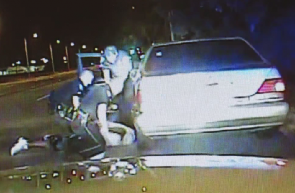 A video released by police shows North Charleston officer Michael Slager using a taser on the motorist after he had been pinned to the ground. (Screenshot)