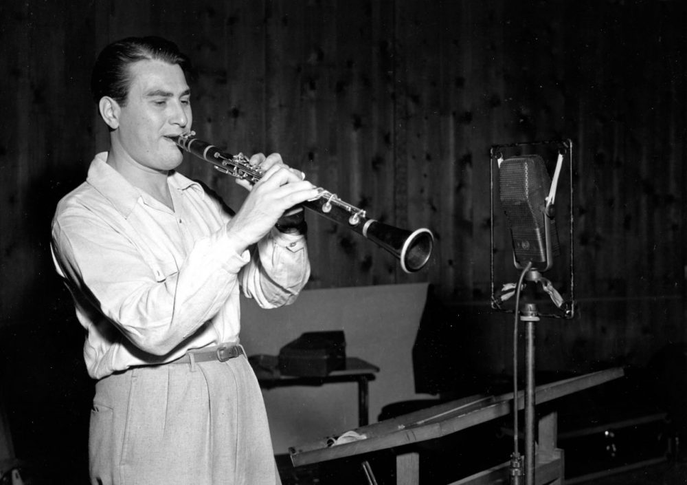"""Artie Shaw plays the clarinet on Sept. 10, 1941. The clarinetist and bandleader's recording of """"Begin the Beguine"""" epitomized the Big Band era. (AP)"""