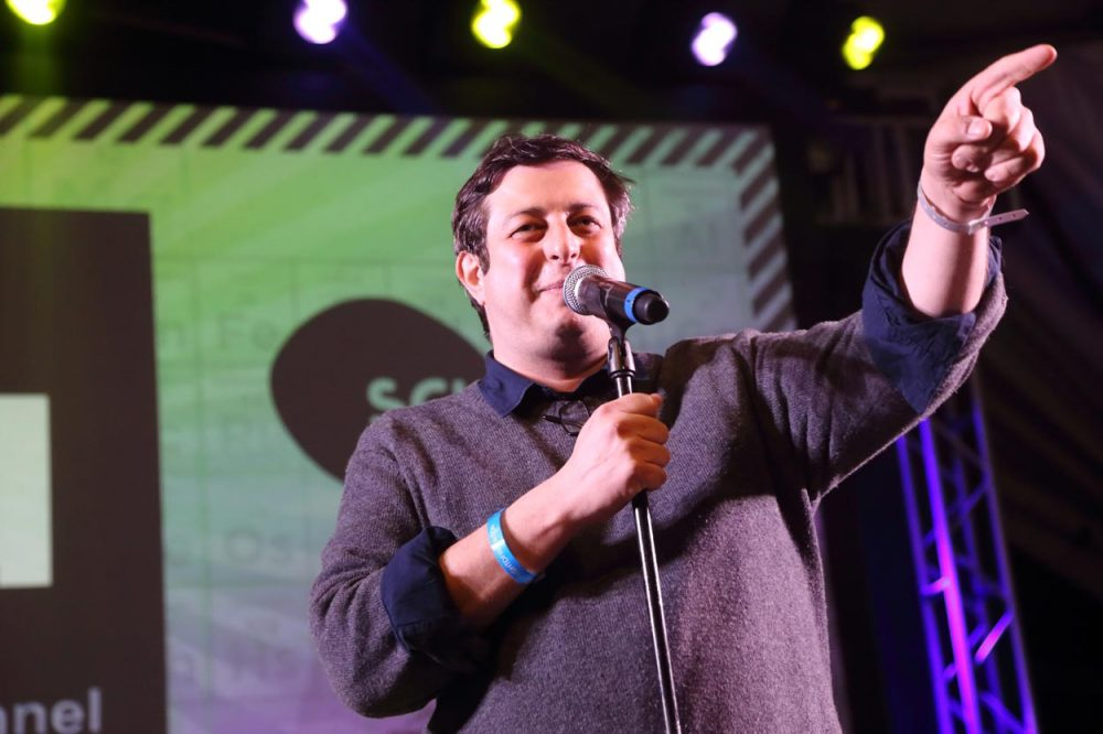 """Comedian Eugene Mirman, pictured here performing during the 2014 SXSW Festival in Austin, Texas, is known for his roles on TV shows like """"Flight of the Concords"""" and """"Bob's Burgers."""" He's back in Boston this weekend for the Eugene Mirman Comedy Festival. (John Davisson/Invision/AP)"""