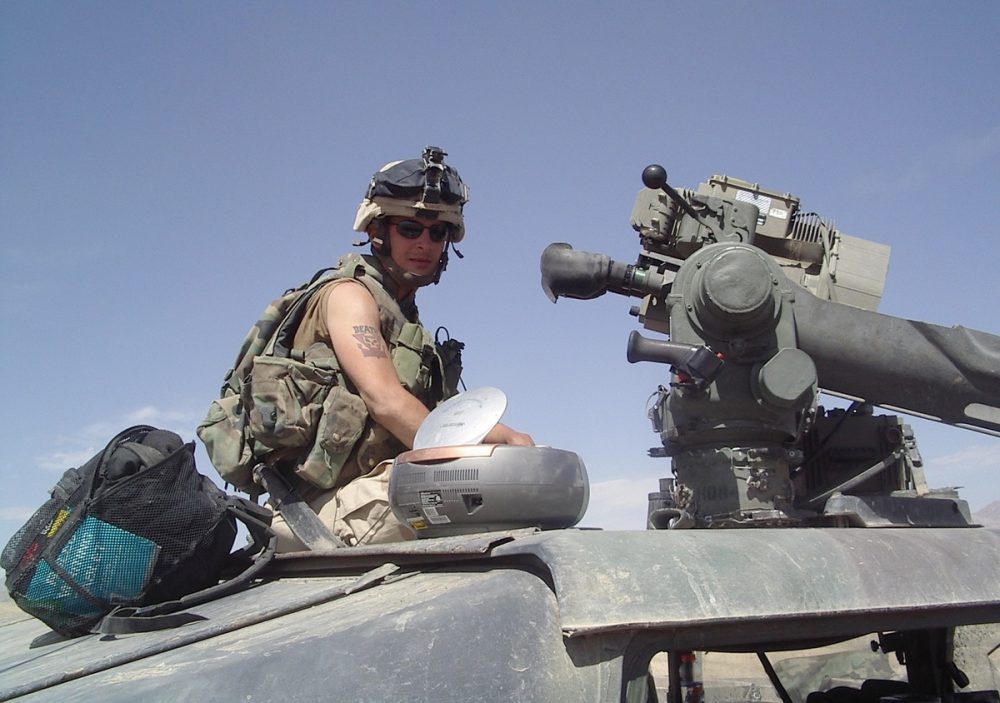 Justin Blodgett in Afghanistan before the helicopter crash that lead to his separation from the Army. (NCPR)