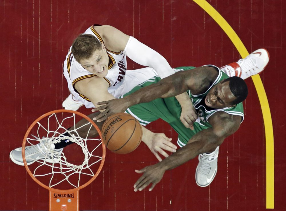 Boston Celtics' Brandon Bass, right, shoots on Cleveland Cavaliers' Timofey Mozgov in the first half of a first round NBA playoff game April 19, 2015, in Cleveland. (Tony Dejak/AP)