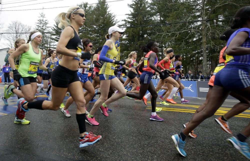 Runners cross the start line in the women's division of Boston Marathon on Monday, April 20, 2015 in Hopkinton, Mass. (Stephan Savoia/AP)