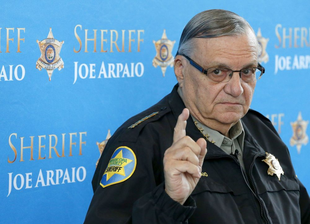 Maricopa County Sheriff Joe Arpaio pauses as he answers a question at a news conference at Maricopa County Sheriff's Office Headquarters in Phoenix, Dec. 18, 2013. (Ross D. Franklin/AP)