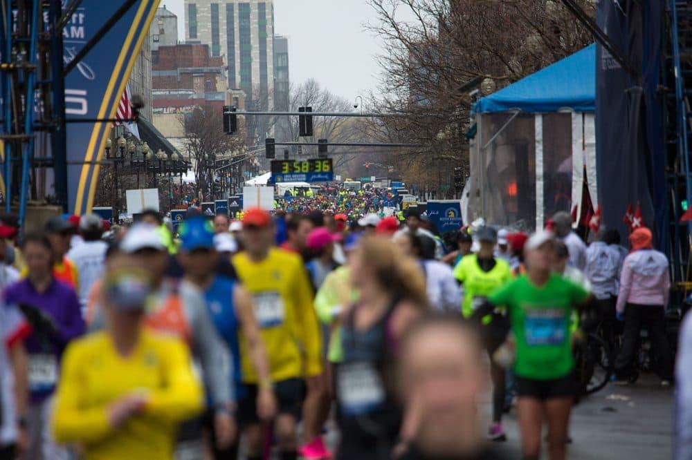 Runners, runners everywhere on Boylston Street (Jesse Costa/WBUR)
