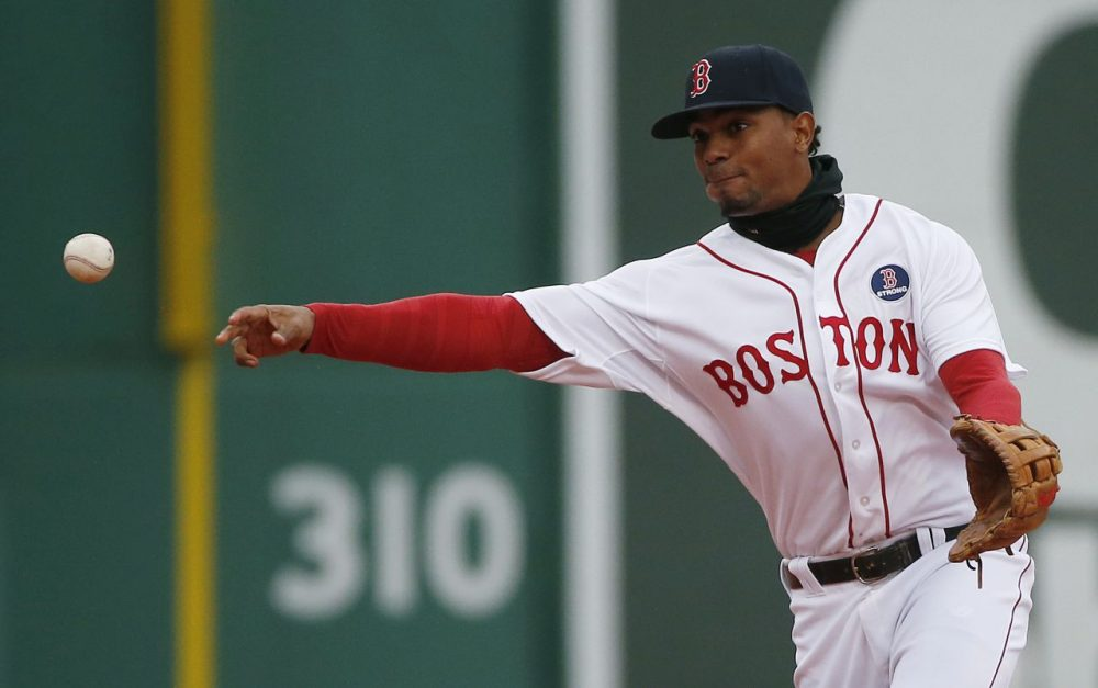 Boston's Xander Bogaerts throws to first base on a ground out by Baltimore's Everth Cabrera during the second inning Monday. (Michael Dwyer/AP)