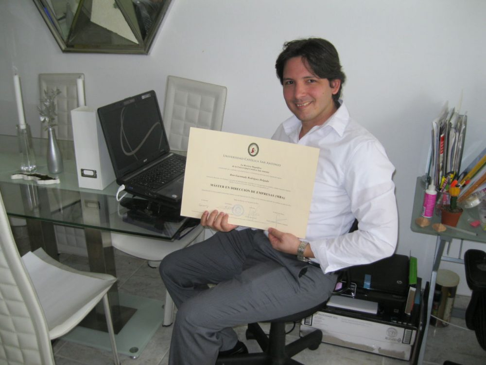 Guennady Rodriguez shows off his Cuban MBA degree at his Miami home. (Tim Padgett / WLRN.org)