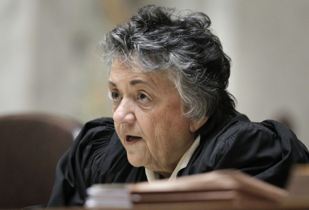 Wisconsin Supreme Court Chief Justice Shirley Abrahamson questions state attorney general J.B. Van Hollen, during arguments in Madison Teachers Inc. vs. Scott Walker, in the Wisconsin Supreme Court at the state Capitol in Madison, Wis., Monday, Nov. 11, 2013. (M.P. King/Wisconsin State Journal via AP)