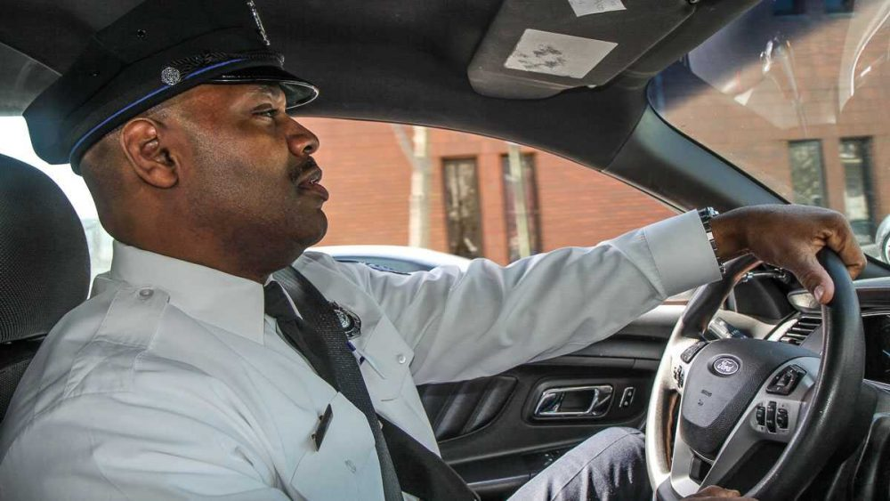 Sgt.Thomas Davis oversees about a dozen or so officers in the18th Police Precinct in West Philadelphia.. (Kimberly Paynter/WHYY)