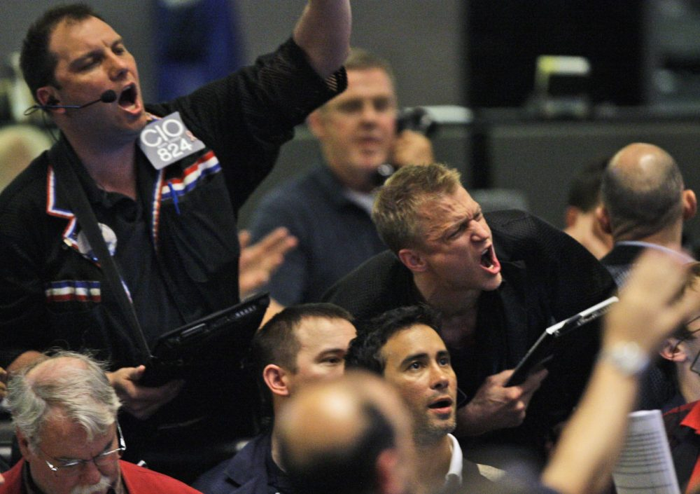 Traders shout orders in the S&P 500 futures pit at the CME Group in Chicago near the close of trading, Thursday, May 6, 2010. The stock market had one of its most turbulent days ever with the Dow Jones industrials plunging nearly 1,000 points in half an hour before recovering two-thirds of its losses. (Kiichiro Sato/AP)
