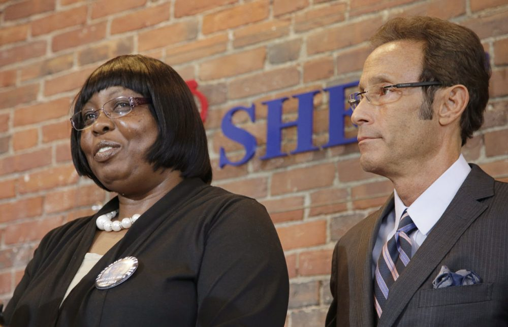 Ursula Ward, left, mother of Aaron Hernandez murder victim Odin Lloyd, speaks about her son while her attorney, Douglas Sheff, looks on during a news conference about Ward's civil case against Hernandez, Wednesday in Boston. (Stephan Savoia/AP)