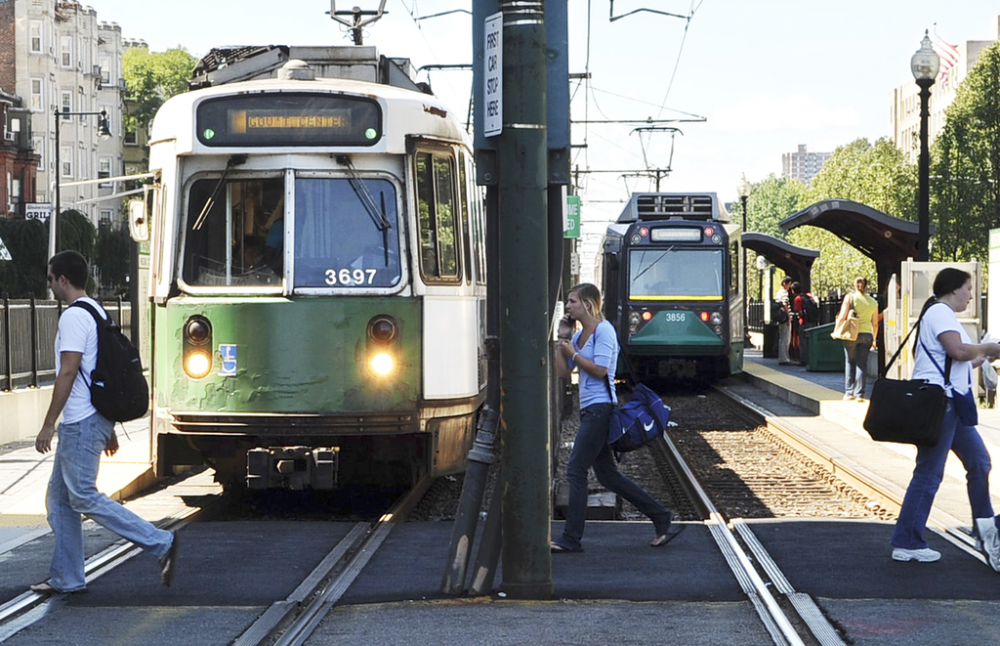 People walk by the Green Line along Commonwealth Avenue in Boston, in this 2008 file photo. (Lisa Poole/AP)