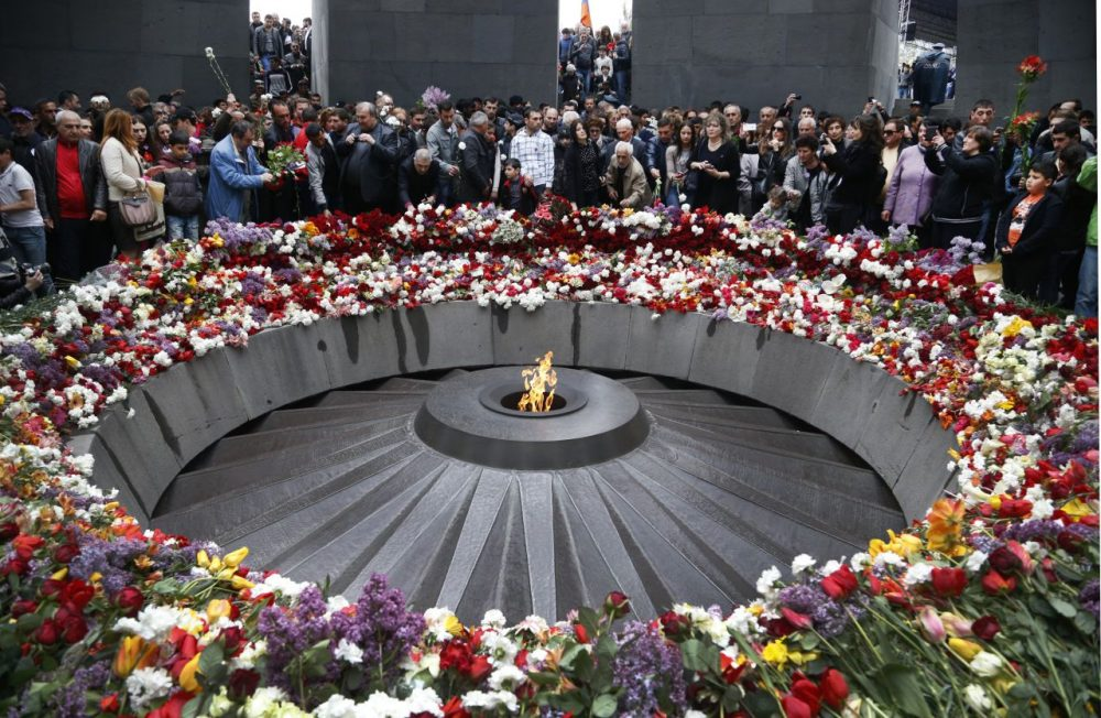 People lay flowers at a memorial to Armenians killed by the Ottoman Turks. Friday marks the centenary of what historians estimate to be the slaughter of up to 1.5 million Armenians by Ottoman Turks. (Sergei Grits/AP)