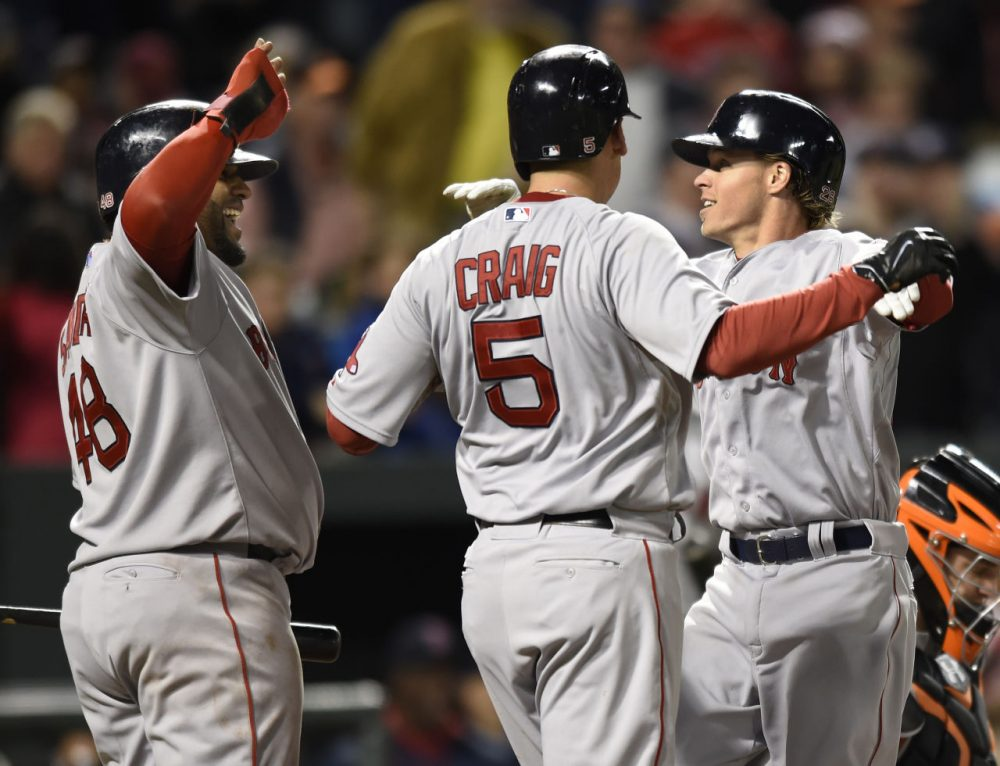 Red Sox's Brock Holt, right, celebrates his three run home run with Allen Craig, center, and Pablo Sandoval in the eighth inning against the Orioles, Friday, April 24, 2015, in Baltimore.  (AP Photo/Gail Burton)