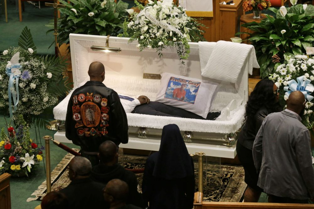 Mourners view the body of Freddie Gray before his funeral at New Shiloh Baptist Church, Monday, in Baltimore. Gray died from spinal injuries about a week after he was arrested and transported in a Baltimore Police Department van. (Patrick Semansky/AP)