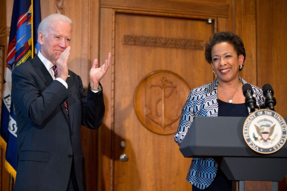 Vice President Joe Biden applauds as Loretta Lynch speaks at the Justice Department in Washington, Monday, after Biden administered the oath of office to Lynch as the 83rd Attorney General of the U.S. (Andrew Harnik/AP)