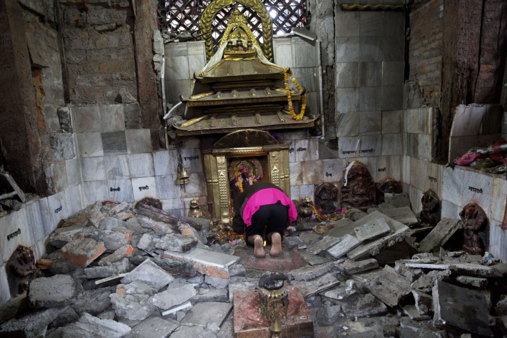 A Hindu Nepalese woman offers prayers at Indrayani temple that was damaged in Saturday's earthquake in Kathmandu, Nepal. (Bernat Armangue/AP)