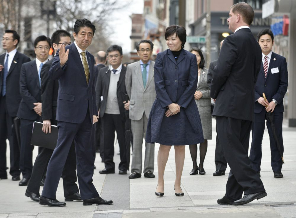 Japanese Prime Minister Shinzo Abe, center left, waves, as he and wife Akie, center, greet Boston Mayor Martin Walsh, second from right, after placing a wreath at the site of one of the 2013 marathon bombings Monday in Boston. On Wednesday, he will become the first Japanese leader to address a joint session of Congress. (Josh Reynolds/AP)
