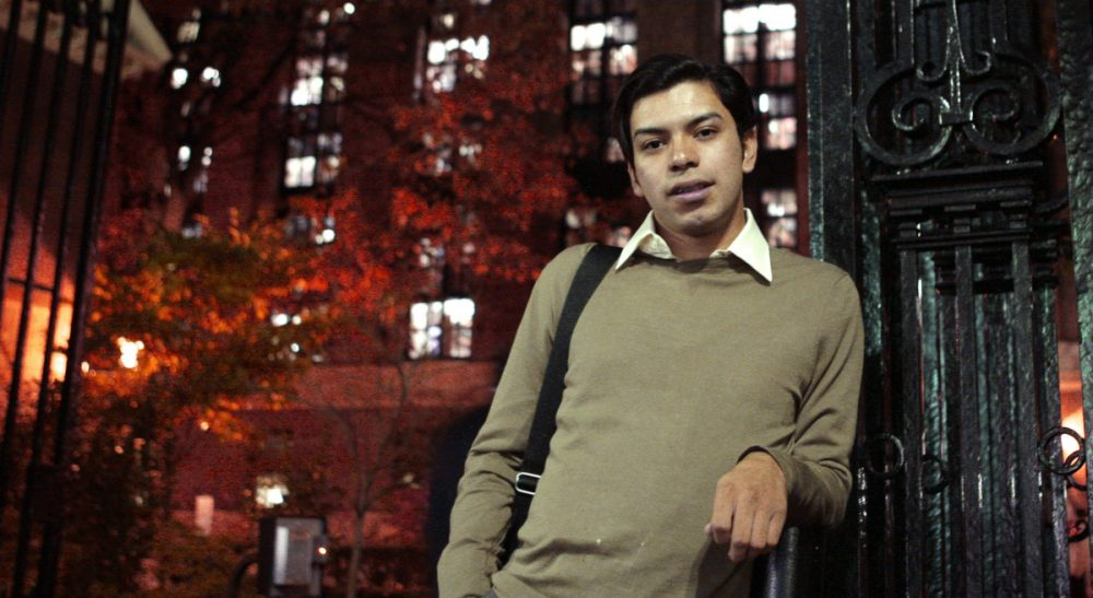 Mario Rodas of Chelsea, Mass., poses at one of the gates at Harvard University in Cambridge, Mass. on Nov. 2, 2009. As an undocumented Guatemalan-born immigrant, Rodas would have had to pay out-of-state tuition fees to go to a public college in Massachusetts. Rodas has since been granted asylum in the U.S. and studies at the Harvard University Extension School which has one tuition rate for all students. (Charles Krupa/AP)