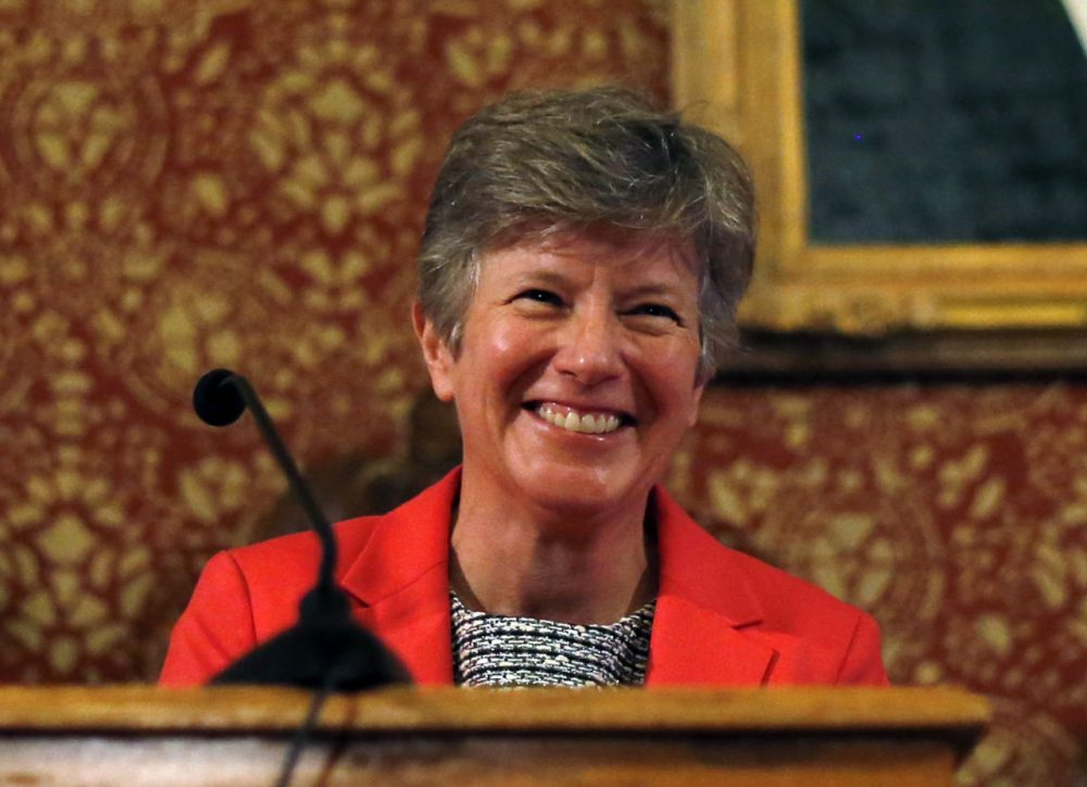 In this 2014 file photo, attorney Mary Bonauto smiles at Cambridge City Hall to mark the 10th anniversary of the first same-sex weddings in Massachusetts. (Elise Amendola/AP)