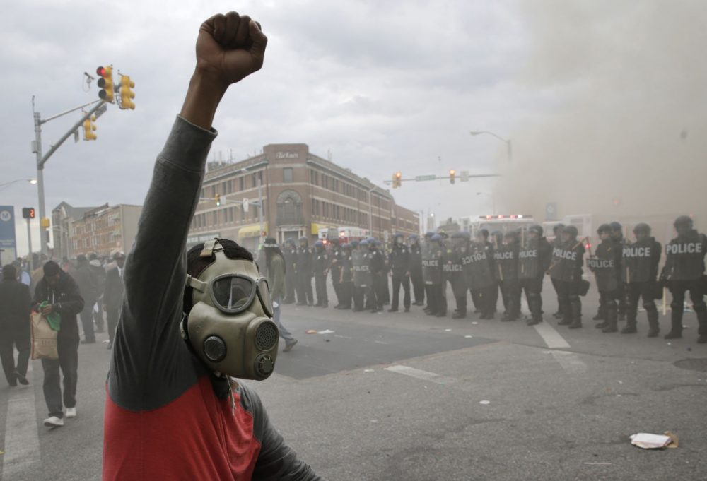 The Harvard poll findings come as anger over the death of Freddie Gray, a 25-year-old Baltimore resident, turned violent this week. (Patrick Semansky/AP)