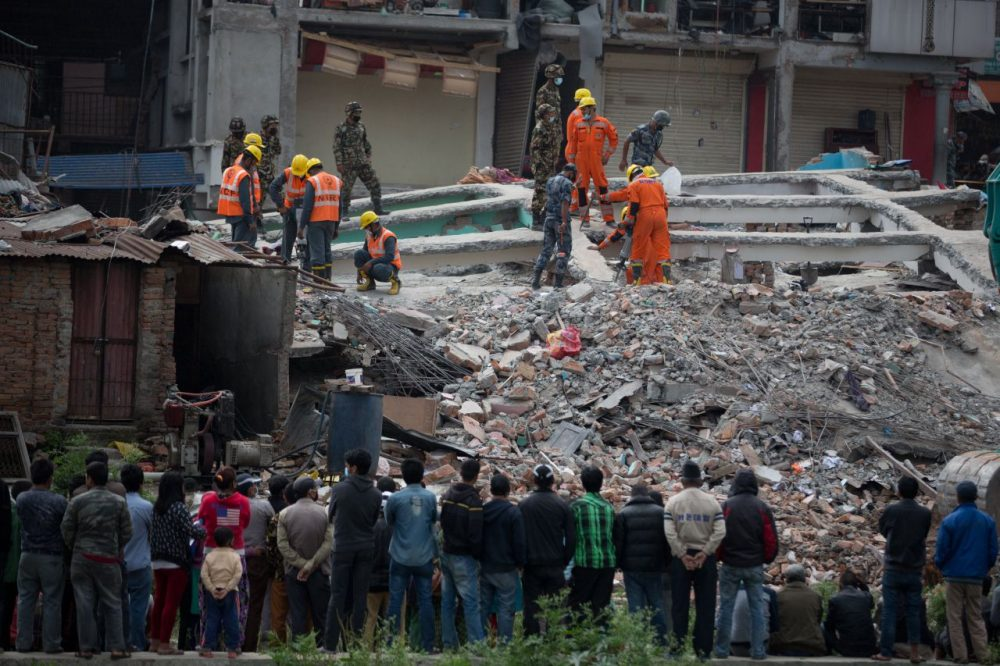 Rescue officials search through rubble in the earthquake damaged area in Kathmandu on April 29, 2015. (Menahem Kahana/AFP/Getty Images)