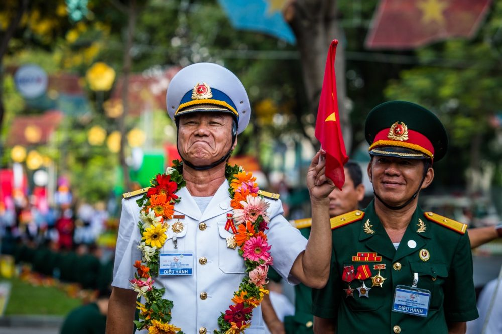 Men in military leadership pose for a portrait during the Reunification Day parade Thursday in Ho Chi Minh City. (Quinn Ryan Mattingly for WBUR)