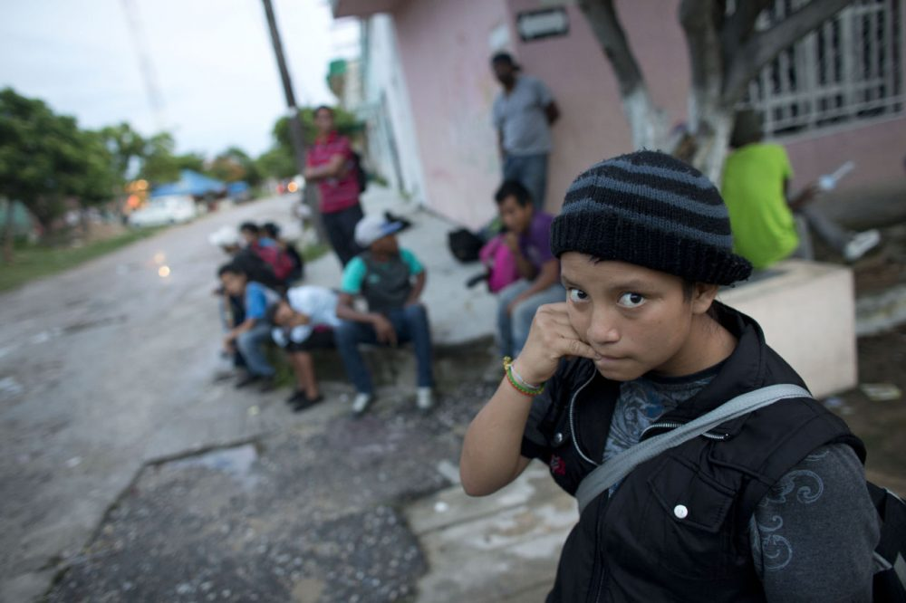 In this June 19, 2014 photo, a 14-year-old Guatemalan girl traveling alone waits for a northbound freight train along with other Central American migrants, in Arriaga, Chiapas state, Mexico. The United States has seen a dramatic increase in the number of Central American migrants crossing into its territory, particularly children traveling without any adult guardian. More than 52,000 unaccompanied children have been apprehended since October. (Rebecca Blackwell/AP)