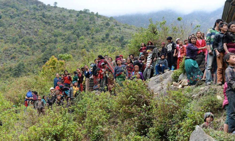 Nepalese villagers wait for relief aid from an Indian Army helicopter at Uiya village, in northern-central Gorkha district on April 29, 2015. Hungry and desperate villagers rushed towards relief helicopters in remote areas of Nepal, begging to be airlifted to safety, four days after an earthquake killed more than 5,000 people. (Saijad Hussain/AFP/Getty Images)