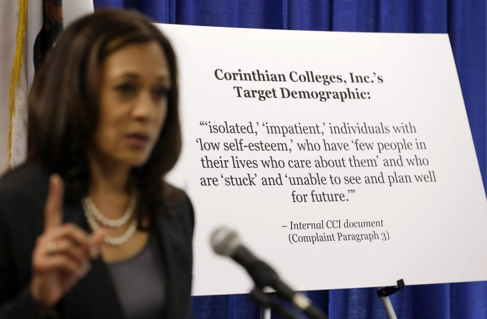 California Attorney General Kamala Harris gestures while standing by a display showing an internal document showing the target demographic of Corinthian Colleges in 2013. Harris sued the college company, alleging it misrepresented job placement rates to lure low-income state residents. Corinthian is closing its 28 remaining campuses, displacing about 16,000 students. (Eric Risberg/AP)